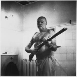 Hemingway wielding a bigass shotgun